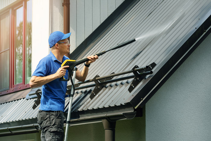 Cleaning house metal roof