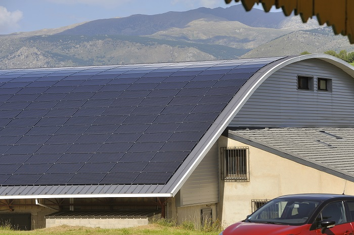 A curved roof with solar panels