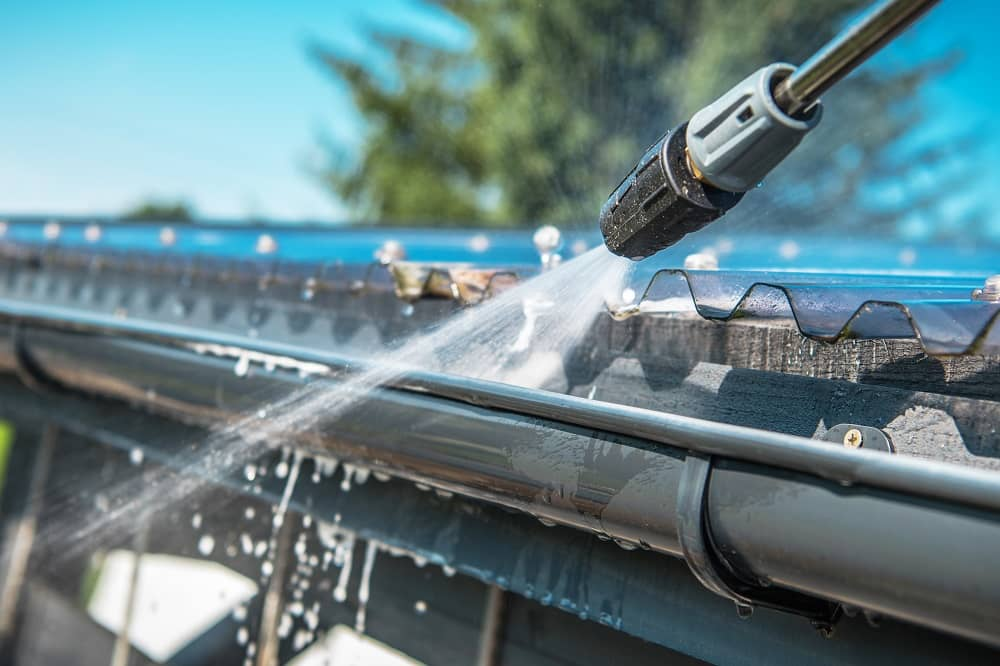A pressure washer can help clean gutters